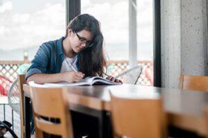 homeschooling female at desk