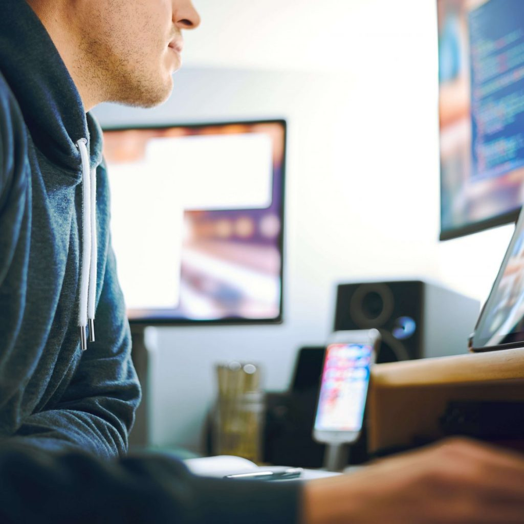 man working remotely at desk