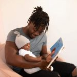 parenting advice daddy holding baby